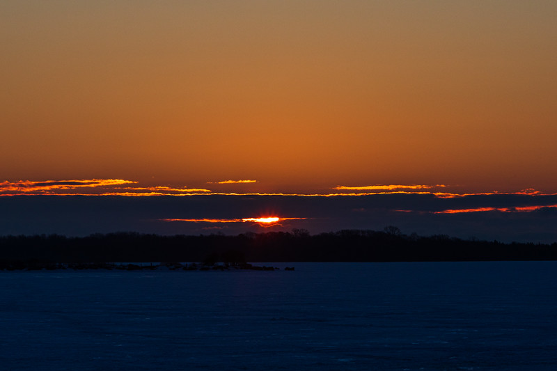 Sunrise through the clouds across the Bay of Quinte 2021 February 26