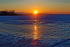 Reflection from sunrise starts to light up the ice on the near shore of the Bay of Quinte.