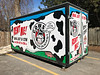 Rented container in parking lot behind 210 Dundas Street East. Cows containers on wheels.