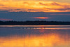 Orange and purple along the Bay of Quinte before sunrise. Swans crossing the Bay.