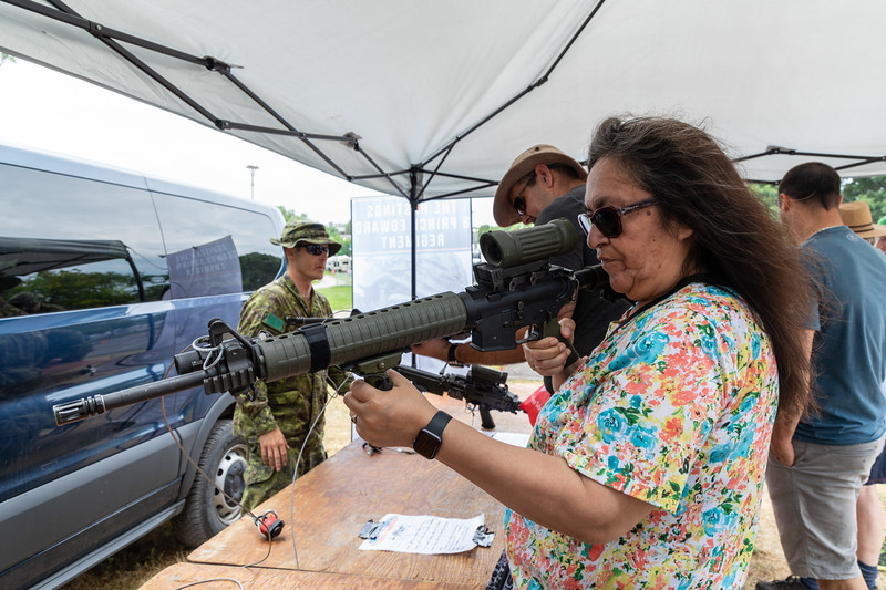Denise Lantz trying out a weapon
