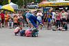 Busker jumping over children.
