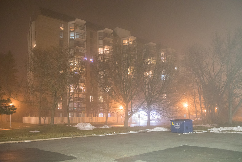 Foggy night view of Prince William Apartments.