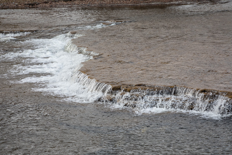 Water flowing over a shelf in the Moira River just below the Lott Dam.