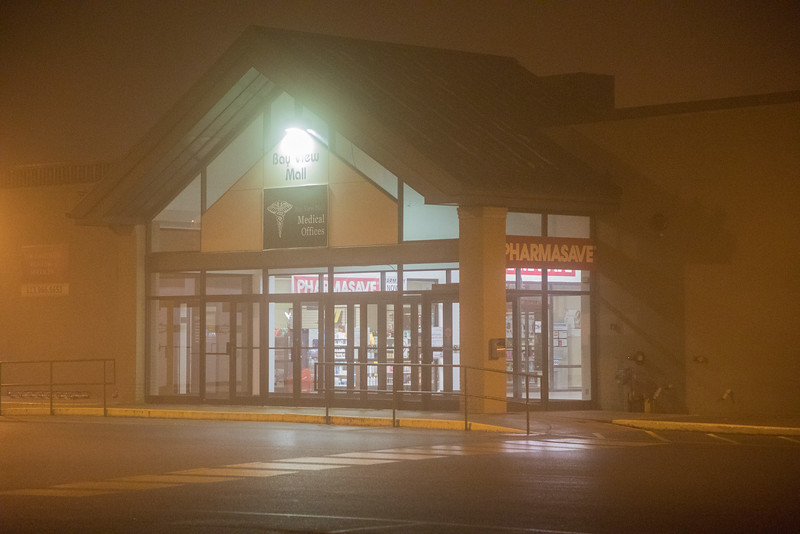 Foggy night v iew of Bayview Mall entrance.