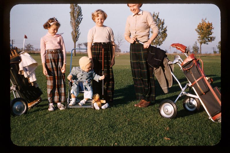 Helen Lantz with two girls and Paul Lantz golfing. 1955