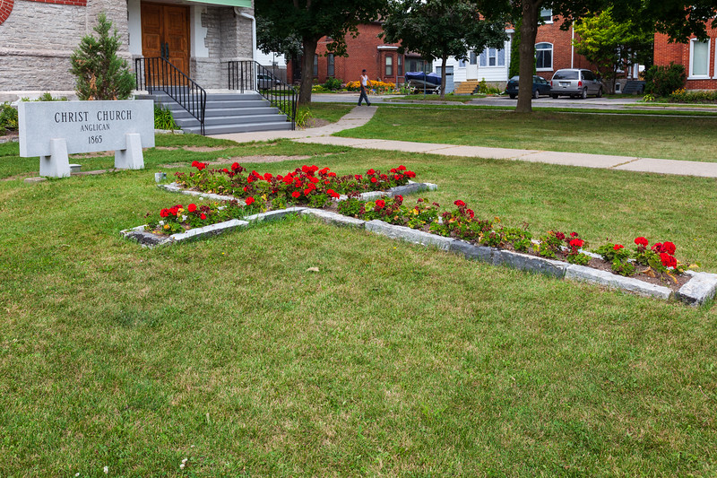 Flowers in cross shape on lawn of Christ Church Anglican in Belleville.