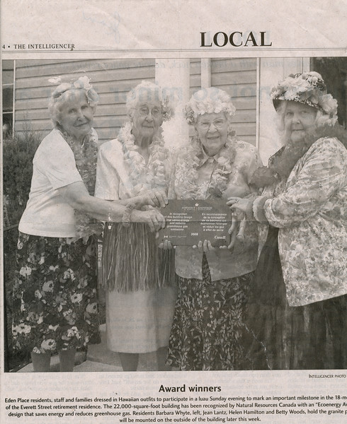 Eden Place Retirement Home residents Barbara Whyte, Jean Lantz, Helen Hamilton and Betty White hold a Natural Resources Canada Ecoenergy Award given to their residence. Date estimated.