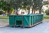 Dumpster in Rossmore for flood debris moved.