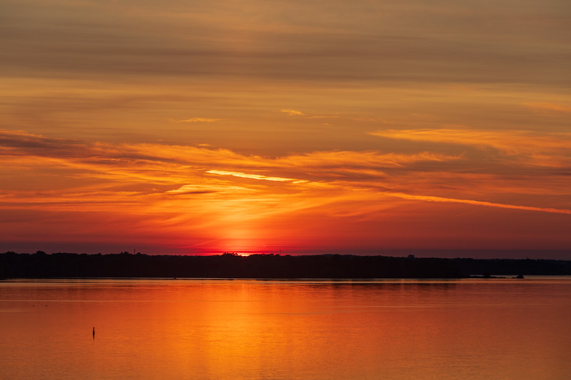 First glimpse of the sun down the Bay of Quinte 2019 July 9