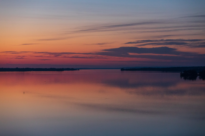 Red lights on bouy visible in this view down the Bay of Quinte from the Norris Whitney Bridge a little more than half an hour before sunrise.