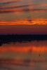 Sky shadow reflected in the water of the Bay of Quinte before sunrise at Belleville Ontario 2019 June 28