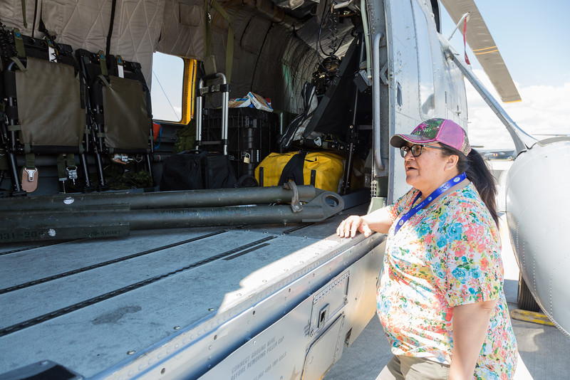 Denise Lantz looking into Sea King helicopter