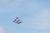 Nine snowbirds in formation over Belleville