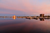 Looking up the Bay of Quinte just before sunrise. Purple sky reflected in the water. Glass at Meyers Pier reflects sky.