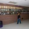 The wall of heroes.  Pat Johnson Brecht looks in vain for classmates.  The photos of the 1963 heroes are being restored.