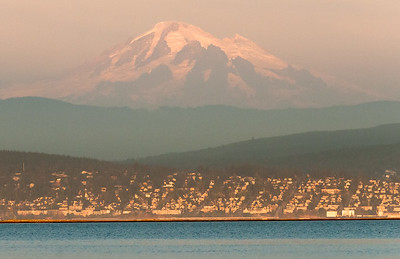 Mt Baker from Lummi Indian Nation across from Bellingham Bay at sunset.