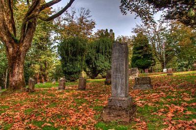 cemetery-grave-stones-fall-leaves-2