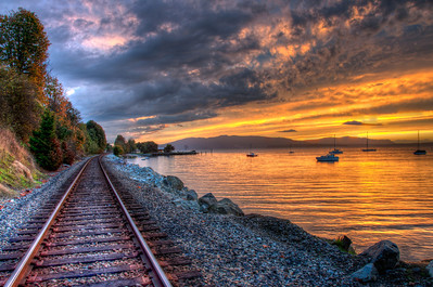 clouds-tracks-bay-sunset