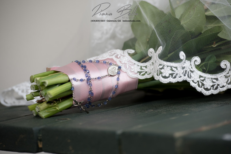 The bride added a special rosary to her bouquet