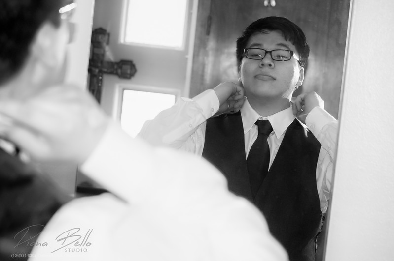 Groom getting ready before ceremony.