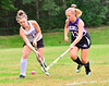 Bellows Falls' Ella Clark and Brattleboro's Nicole Potter battle for control of the ball during a field hockey match at Bellows Falls Union High School on Tuesday, Sept. 14, 2021.