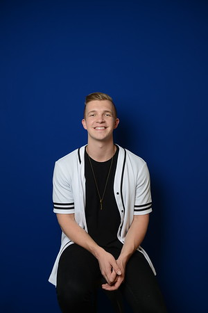 admissions shoot with blue background