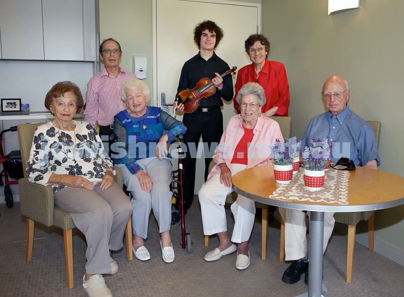 Gerald Westheimer (right) with young violinist Ben Adler (middle) with a vintage violin. Pictured at Montefiore Home in Randwick with family and friends. Pic Noel Kessel.
