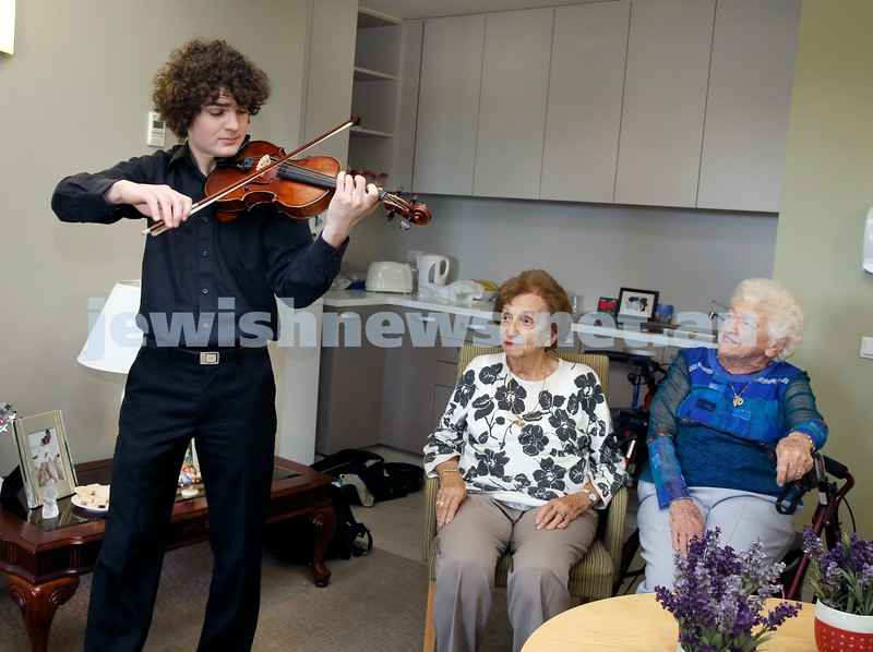 Young violinist Ben Adler with a vintage violin playing at Montefiore Home in Randwick. Pic Noel Kessel.