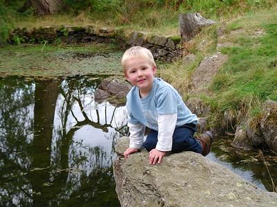 Ben beside Pool on path to Alcock Tarn