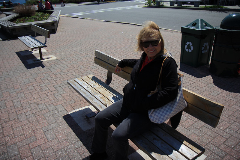 Pat resting on a bench