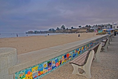 The wall along the beachfront sidewalk in Capitola Village. The tiles were purchased by individuals for $35.00 ea. as a fundraiser for Capitola. The individuals then handpainted their creation of choice; to be applied as the wallfront. GREAT idea!!  There is MUCH more tile covered wallspace than shows in this photo. I thoroughly enjoyed the time I spent  checking out this wonderful art project!  Make sure to check out a close-up look at some of the tiles in my Contender gallery.  City of Capitola