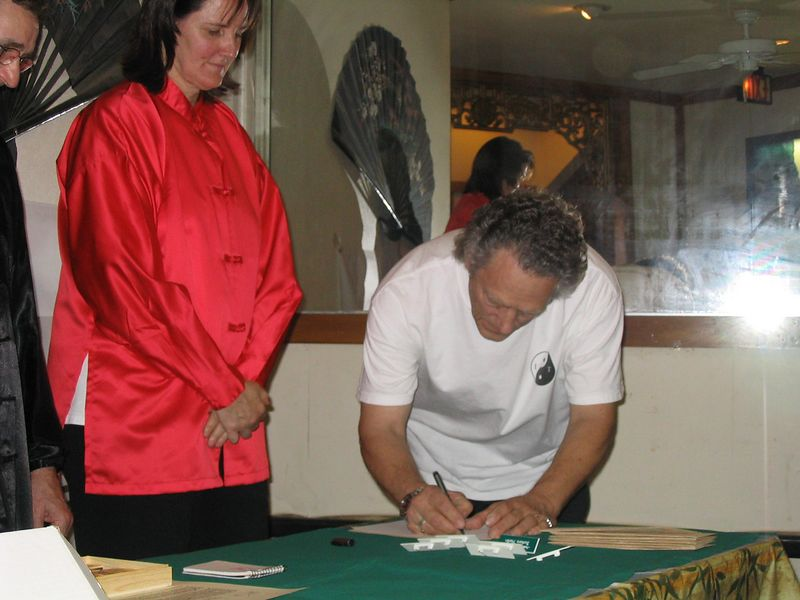 William Osborn sings his Chinese symbol making his Assistant Instructor commitment during the signing ceremony.  Oct. 18, 2003