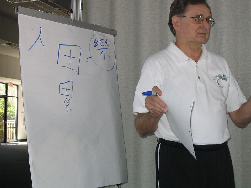 The Wonderful Phillip in Action!  Phillip Szpiech instucts on the meaning and stroke choice of Chinese Writing.  Oct. 18, 2003
