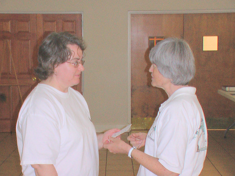 Kim Smith receives her graduation card from Bonnie Osborn for Longevity Tree on May 31, 2006 at EEC.