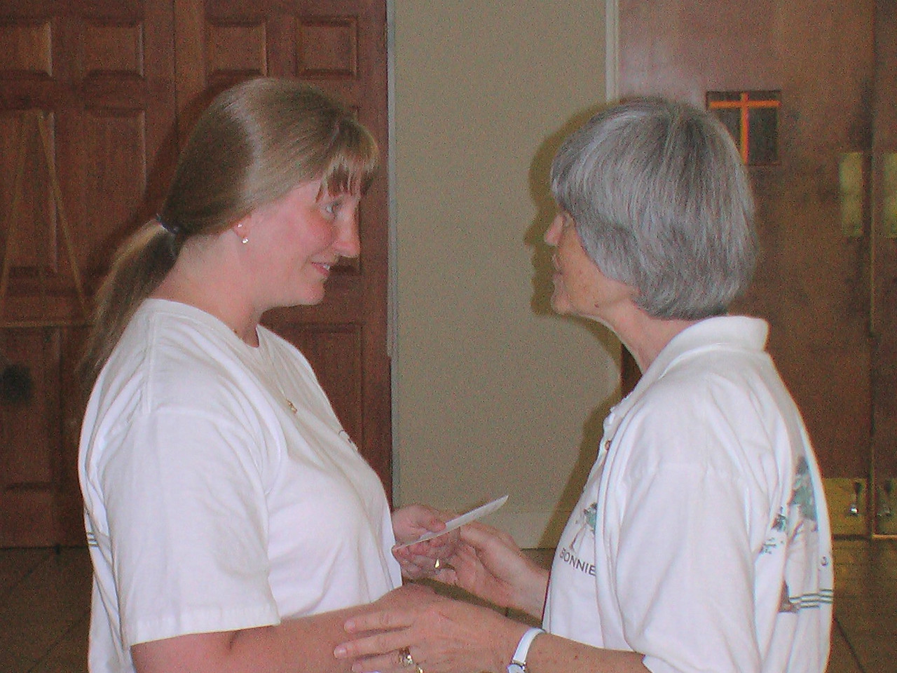 Tamara receives her graduation card for Longevity Tree from Bonnie Osborn May 31, 2006 at EEC.