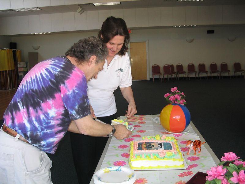 Judith Forsyth and William Osborn serve cake to the TCA Instructors.