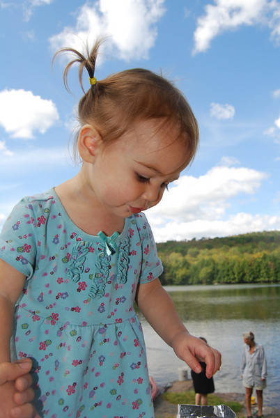 Early in the afternoon, 17 month old Lily Cahill celebrates the river with friends and family at a semi-private event at the refreshingly clear, spring fed Basket Pond in Acidalia, NY.  The pond is one of many bodies of water that flows into the river and will also be directly affected by the gas drilling in the Delaware River Basin.  Copyright®Nyssa Calkin of Diamond Cut Images