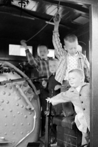 4 boys in engine cab