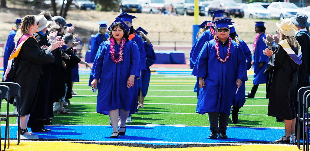 . BENICIA, CA - JUNE 9, John Alagon and Samina Adel lead the seniors on the field during graduation at Benicia High School on Saturday. (CHRIS RILEY/TIMES-HERALD)