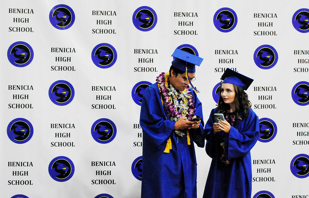. BENICIA, CA - JUNE 9, Sean Butawan and Melina Osmundson share information before graduation at Benicia High School on Saturday. (CHRIS RILEY/TIMES-HERALD)
