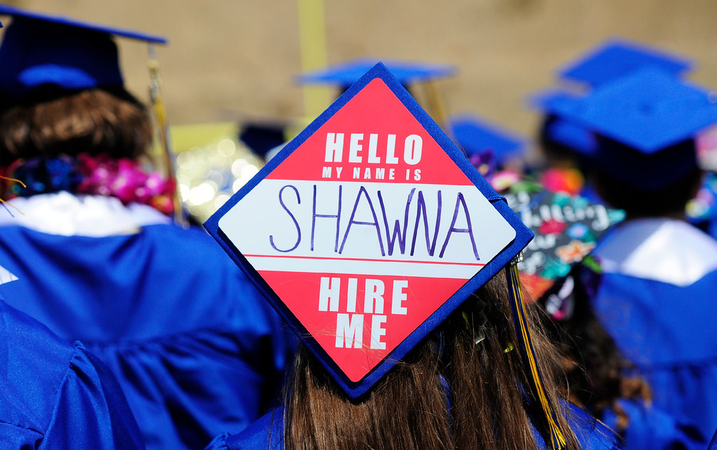 . BENICIA, CA - JUNE 9, Shawna Williams uses her cap to look for a job during graduation at Benicia High School on Saturday. (CHRIS RILEY/TIMES-HERALD)