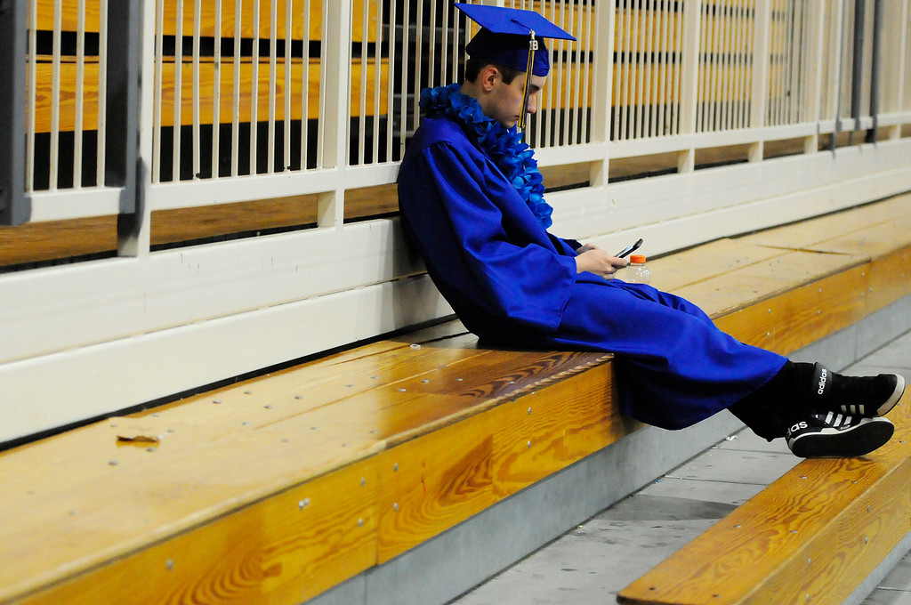 . BENICIA, CA - JUNE 9, Leandre Guertin takes a moment to rest before graduation at Benicia High School on Saturday. (CHRIS RILEY/TIMES-HERALD)