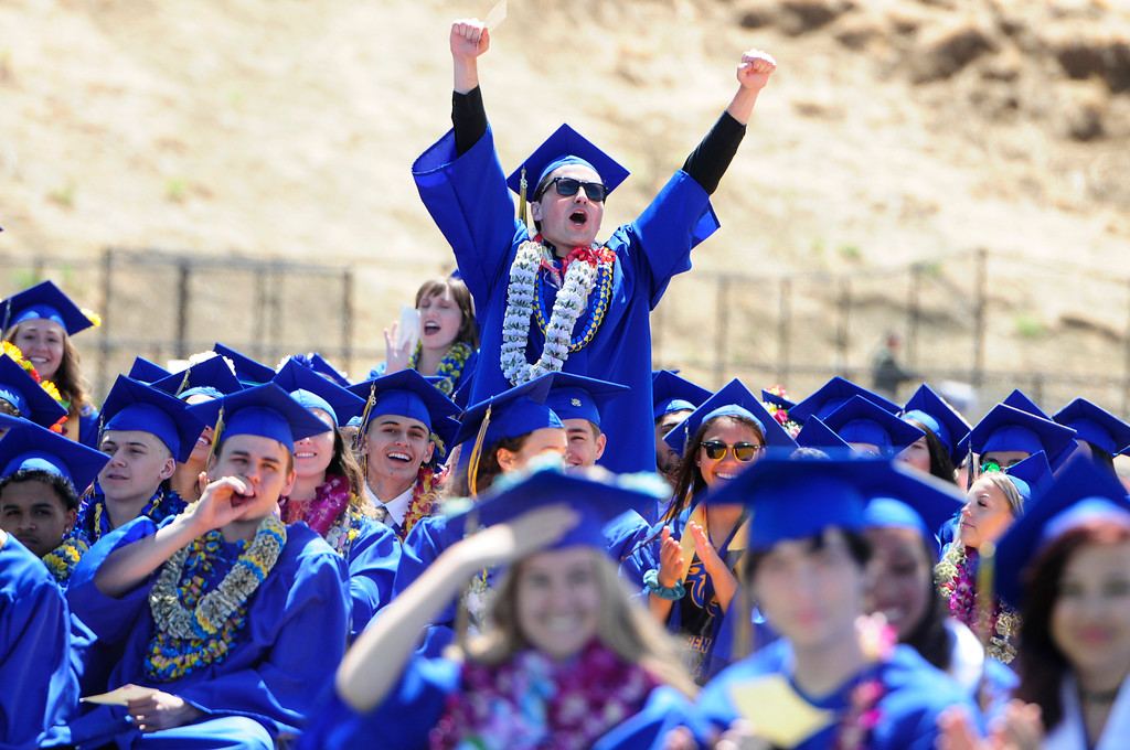 . BENICIA, CA - JUNE 9, A graduate cheers for a faculty member during graduation at Benicia High School on Saturday. (CHRIS RILEY/TIMES-HERALD)