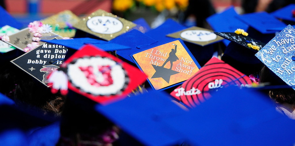 . BENICIA, CA - JUNE 9, A graduates make a statements with their caps during graduation at Benicia High School on Saturday. (CHRIS RILEY/TIMES-HERALD)