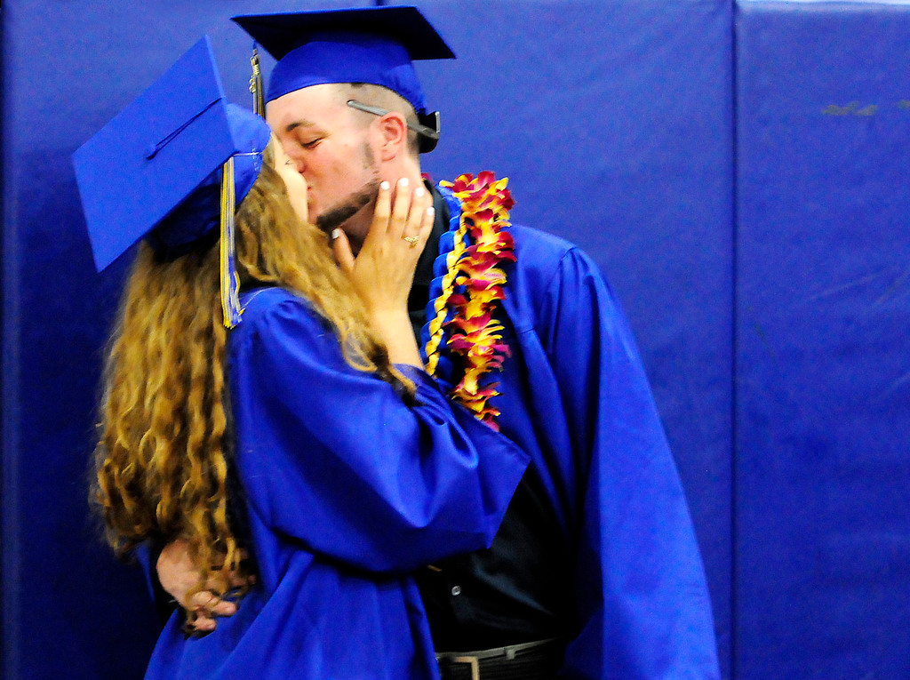 . (Chris Riley/Times-Herald) Payton Cornelius kisses Madisyn Kimmel as the two prepare to graduate from Benicia High School on Saturday.