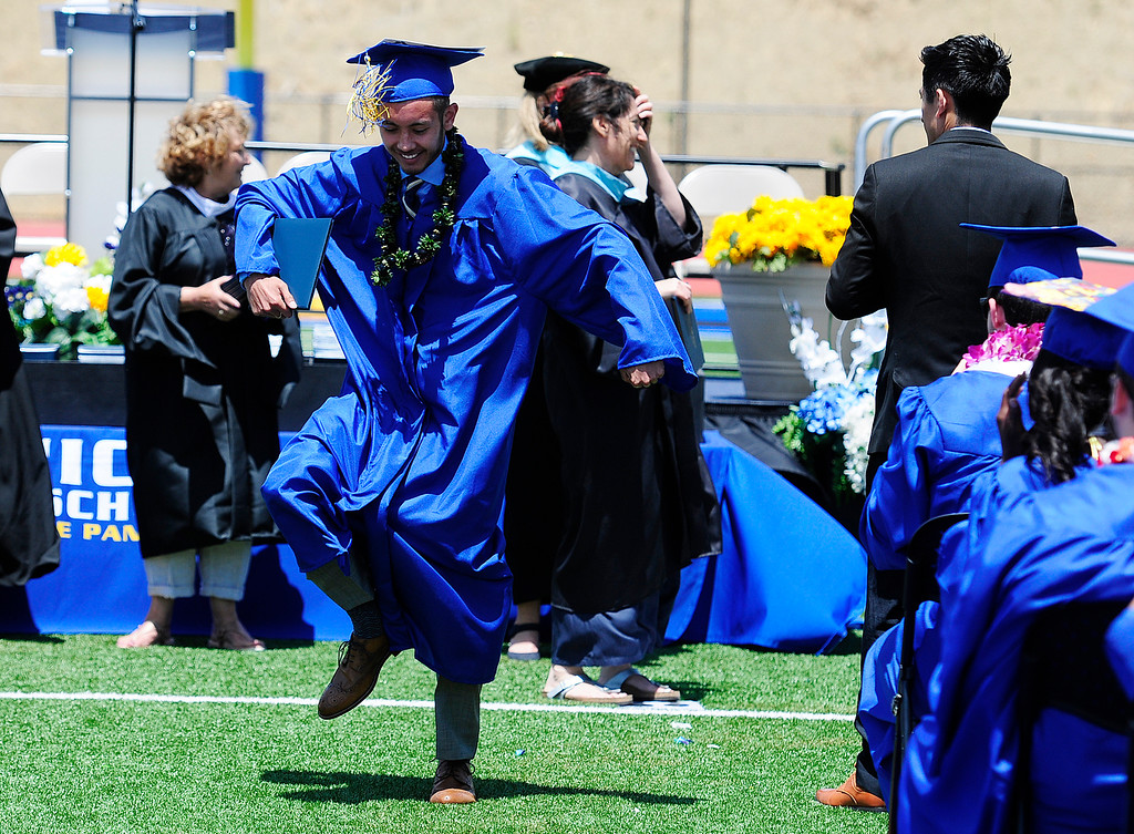 . BENICIA, CA - JUNE 9, Nathan Morimoto dances down the aisle after getting his diploma during graduation at Benicia High School on Saturday. (CHRIS RILEY/TIMES-HERALD)