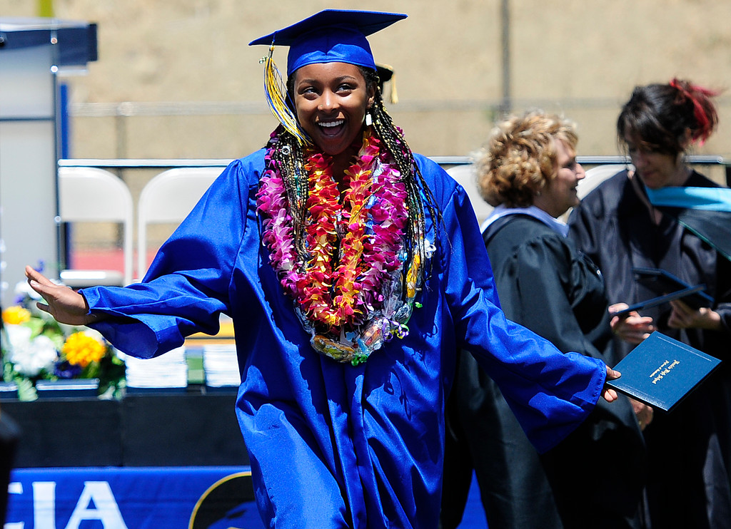 . BENICIA, CA - JUNE 9, A graduate celebrates getting her diploma during graduation at Benicia High School on Saturday. (CHRIS RILEY/TIMES-HERALD)