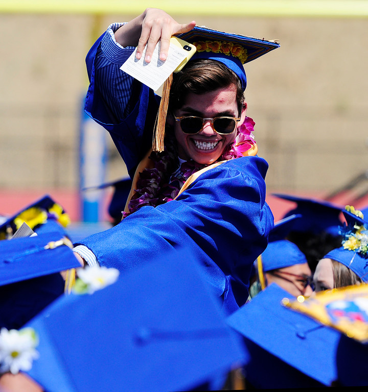 . BENICIA, CA - JUNE 9, Elijah Hahn-Smith waves at a friend during graduation at Benicia High School on Saturday. (CHRIS RILEY/TIMES-HERALD)