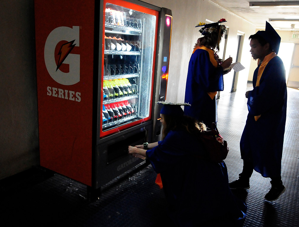 . BENICIA, CA - JUNE 9, Chloe Bonini fishes a Gatorade out of a vending machine before graduation at Benicia High School on Saturday. (CHRIS RILEY/TIMES-HERALD)